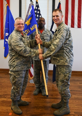 Lt. Col. Mike Evans receives the 131st Mission Support Group guidon from Col Ken Eaves, 131st Bomb Wing Commander, during the change of command ceremony at Jefferson Barracks Air National Guard Base, June 2.