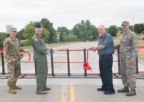 (Left to Right) The Vice Commander of the 509th Bomb Wing, Col. Seth Graham, the Commander of the 442nd Fighter Wing, Brig. Gen. Roger Suro, the Deputy Commander of the 509th Mission Support Group, Mr. Kendall Nugent, and the Deputy Commander of the 509th Mission Support Group, Lt. Col. Anthony DeGregoria cut the ribbon to reopen Arnold Gate on June 4, 2019, at Whiteman Air Force Base, Missouri, with a new barrier. Arnold Gate was shut down, intermittently, due to the construction of a new gate barrier system. (U.S. Air National Guard photo by Senior Airman Bailey Janes)