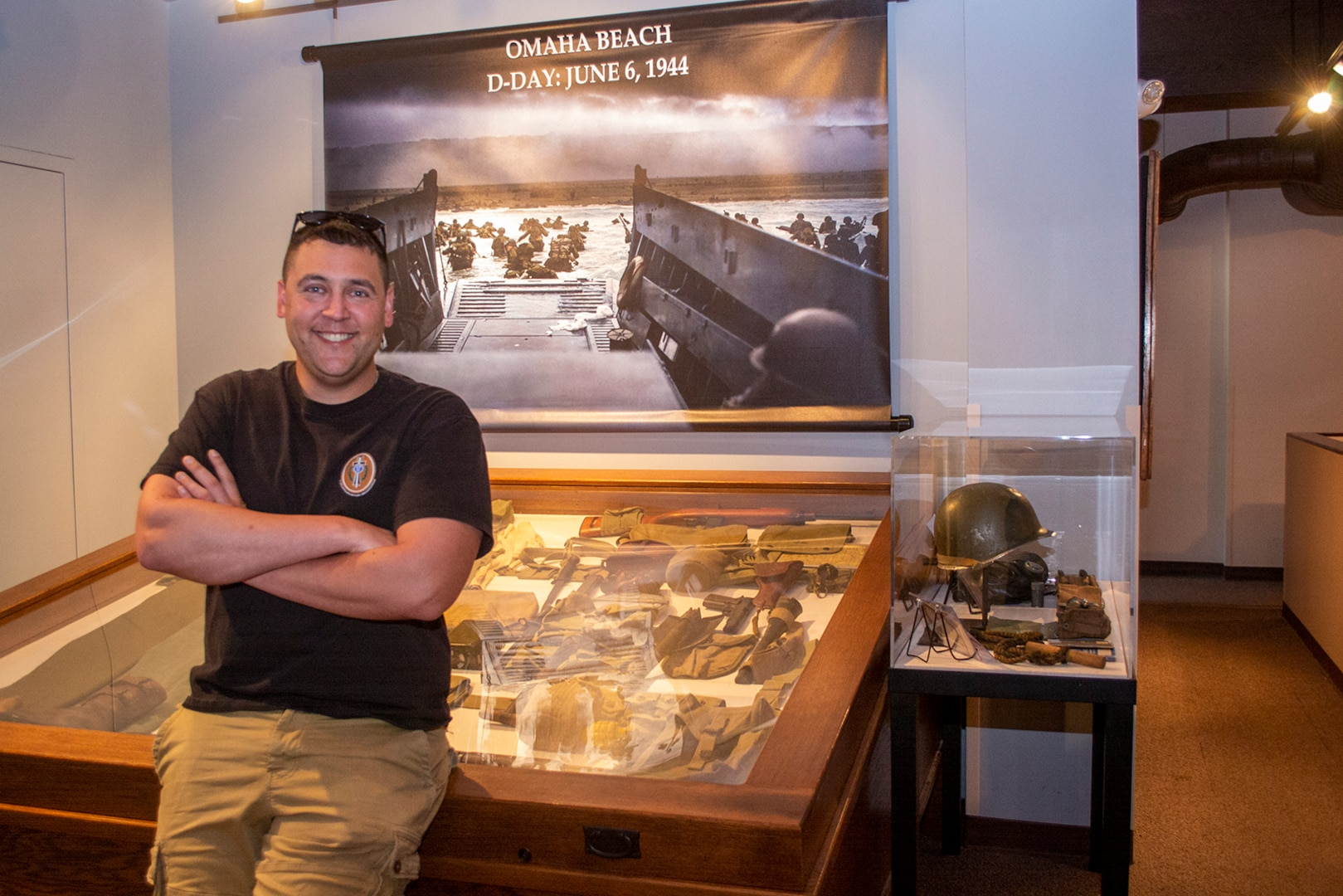 Maj. Michael Hart and some of the World War II artifacts from his personal collection.