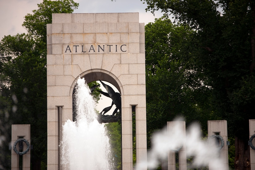 "Water fountains appear in front of a stone arch that bears the word ""Atlantic."""