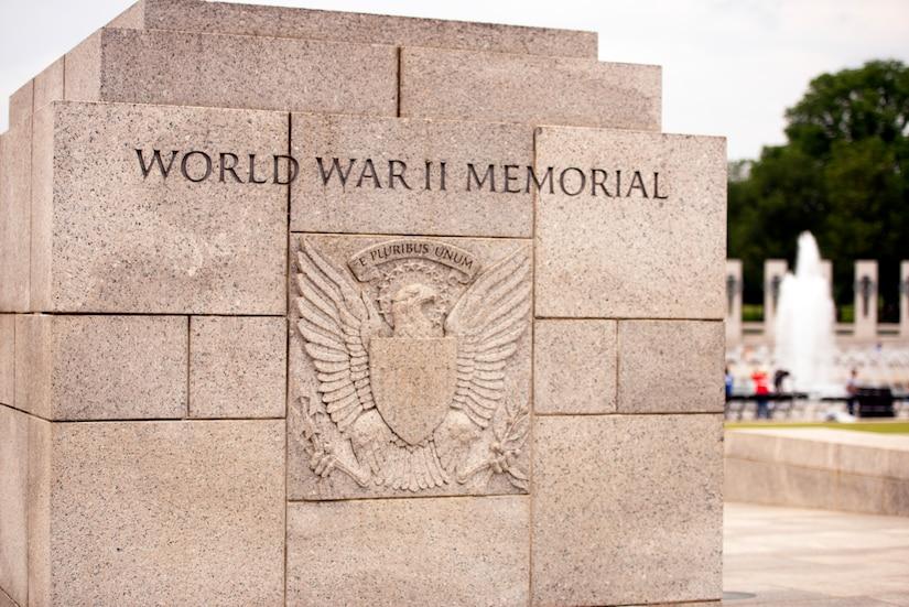 "A stone block bears the words ""World War II Memorial."""