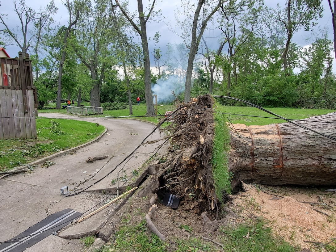 Air Force Research Laboratory employees helped others in need of assistance after multiple tornadoes struck areas surrounding Wright-Patterson Air Force Base during the evening of Memorial Day 2019. Trees were uprooted, roofs were torn off, and in some cases, entire structures were destroyed by the storms. (U.S. Air Force Photo/ Capt. Evan McDowell)