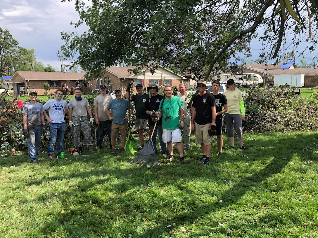 Air Force Research Laboratory employees take time to help colleagues clean up tornado damage. (U.S. Air Force Photo/Matt Berent)