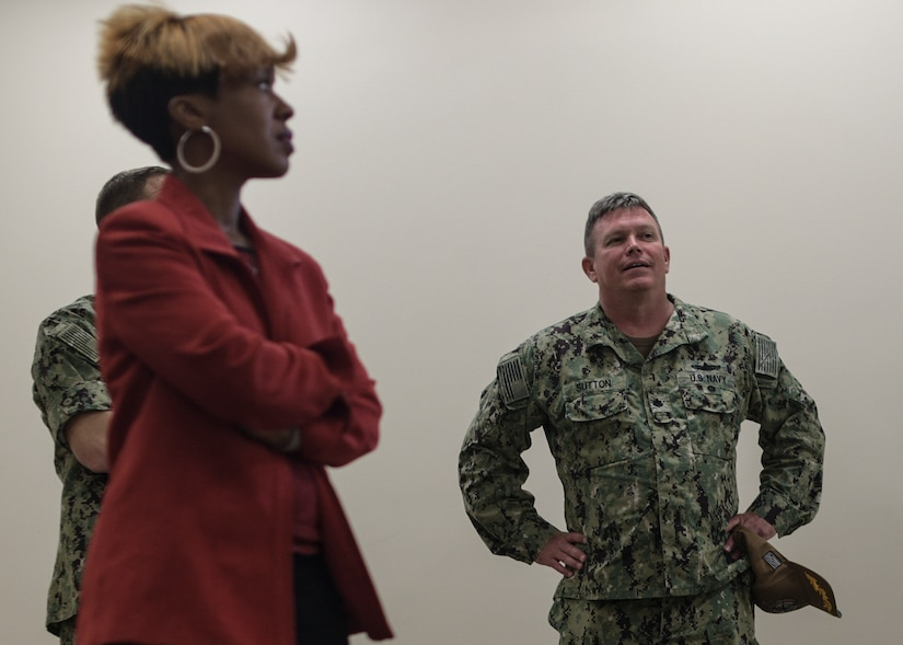 Kai Campbell, left, Saint Leo University regional representative and Commander Pat Sutton, Naval Support Activity executive officer, tour the building allocated to house Joint Base Charleston's Navy College campus June 4, 2019.  The new campus will offer college classes in August 2019 for service members and their families to progress toward their educational goals.