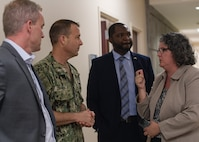 Master Chief Petty Officer John Lonsdale, Naval Support Activity command chief, meets with Educational Administrator to discuss logistics and future goals of Joint Base Charleston's Naval College campus, June 4, 2019. The new campus will offer college classes in August 2019 for service members and their families to progress toward their educational goals. . Military leaders recognize the value and importance of advanced education and encourage members to pursue an education program through one or more of the educational programs available to them.