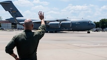 Maj. John R. Blankenship, a B-52 Stratofortress pilot with the 96th Bomb Squadron, waves to his wife Maj. Natasha E. Blankenship, a C-17 Globemaster III pilot with the 183rd Airlift Squadron in Jackson, Mississippi, as she lands a C-17 as apart of the Barksdale Defenders of Liberty Air Show at Barksdale Air Force Base, La., May 16, 2019. Natasha Blankenship is a prior active duty pilot who now flies for the Mississippi Air National Guard. (U.S. Air Force photo by Airman Jacob B. Wrightsman)