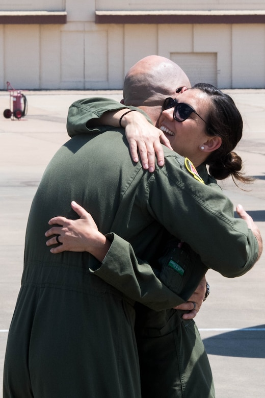 Maj. John R. Blankenship, a B-52 Stratofortress pilot with the 96th Bomb Squadron, hugs his wife Maj. Natasha E. Blankenship, a C-17 Globemaster III pilot with the 183rd Airlift Squadron in Jackson, Mississippi, after she landed her aircraft to be put on display as apart of the Barksdale Defenders of Liberty Air Show at Barksdale Air Force Base, La., May 16, 2019. The Blankenships have duty stations over 200 miles apart and rarely see each other in action. (U.S. Air Force photo by Airman Jacob B. Wrightsman)