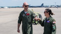 Maj. John R. Blankenship, a B-52 Stratofortress pilot with the 96th Bomb Squadron, and his wife Maj. Natasha E. Blankenship, a C-17 Globemaster III pilot with the 183rd Airlift Squadron in Jackson, Mississippi, gives each other a fist bump after Natasha Blankenship landed her aircraft to be put on display as apart of the Barksdale Defenders of Liberty Air Show at Barksdale Air Force Base, La., May 16, 2019. The Blankenships have a combined 10 deployments under their belts. (U.S. Air Force photo by Airman Jacob B. Wrightsman)