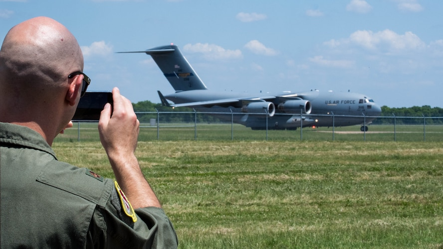 Maj. John R. Blankenship, a B-52 Stratofortress pilot with the 96th Bomb Squadron, records his wife Maj. Natasha E. Blankenship, a C-17 Globemaster III pilot with the 183rd Airlift Squadron in Jackson, Mississippi, as she lands a C-17 as apart of the Barksdale Defenders of Liberty Air Show at Barksdale Air Force Base, La., May 16, 2019. The Blankenships met each other during pilots training and have been married for the past eight years. (U.S. Air Force photo by Airman Jacob B. Wrightsman)