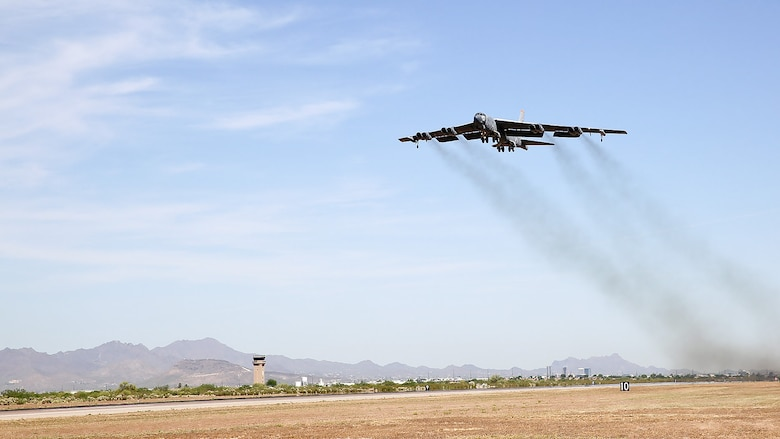 """A B-52H Stratofortress, nicknamed """"Wise Guy,"""" departs Davis-Monthan Air Force Base, Ariz., May 14, 2019. The bomber was flown out of the 309th Aerospace Maintenance and Regeneration Group, also known as the """"Boneyard"""", where it had been since 2008. (U.S. Air Force photo by Col. Jennifer Barnard)"""