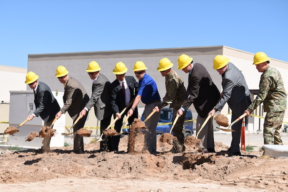 Members of the construction crew and Air Force Research Laboratory officially break ground on the Space Control Laboratory during a groundbreaking ceremony at Kirtland Air Force Base, N.M., June 6, 2019. The new laboratory is scheduled to be completed in July of 2020, and will have 26,000 square feet of laboratory, office and administrative space. (U.S. Air Force photo by Senior Airman Eli Chevalier)