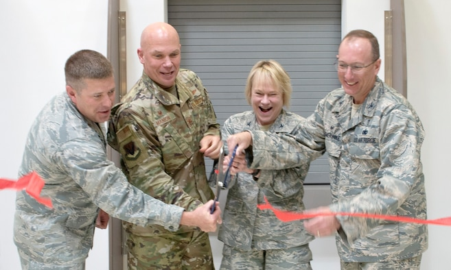 Col. Michael Manion, 2nd from the left, 55th Wing commander and 55th Medical Group leadership, cut the ribbon signifying the opening of the new satellite pharmacy located at the Offutt Air Force Base, Nebraska, Base Exchange. The pharmacy gained approximately thirty percent in square footage, giving them additional space not only to fill and manage prescriptions, but also for patient processing lines.