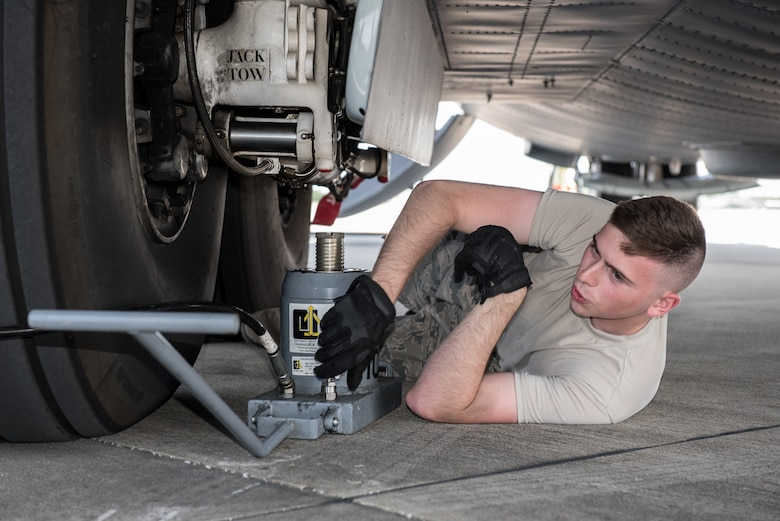 Airman 1st Class Matthew Dunlap, a crew chief in the Kentucky Air National Guard's 123rd Airlift Wing, secures an aircraft jack in preparation for a class on how to change tires on C-130 Hercules aircraft at Maintenance University in Savannah, Ga., May 18, 2019. The four-day intensive training event was held at the Combat Readiness Training Center from May 19 to 22.