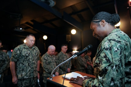 U.S. Navy Lt. Cmdr. Adrienne Benton, a chaplain assigned to the Naval Weapons Station, prays with the attending members during a Battle of Midway commemoration, June 6, 2019, at Joint Base Charleston's Naval Weapons Station, S.C. The ceremony highlighted the contributions of U.S. Sailors to the success at Midway during World War II. The Battle of Midway took place between June 4, 1942, and June 7, 1942, six months after Japan's attack on Pearl Harbor. (U.S. Air Force photo by Senior Airman Thomas T. Charlton)