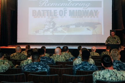 U.S. Navy Cmdr. Pat Sutton, Naval Support Activity executive officer, explains the Navy's critical role in the nation's defense during a Battle of Midway commemoration, June 6, 2019, at Joint Base Charleston's Naval Weapons Station, S.C. The ceremony highlighted the contributions of U.S. Sailors to the success at Midway during World War II. The Battle of Midway took place between June 4, 1942, and June 7, 1942, six months after Japan's attack on Pearl Harbor. (U.S. Air Force photo by Senior Airman Thomas T. Charlton)