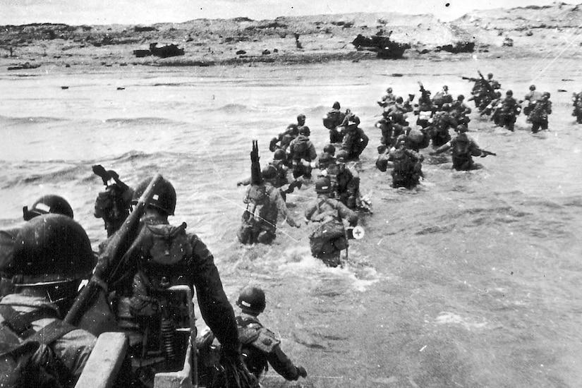 Troops wade ashore