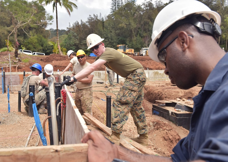 Over 50 service members from the U.S. Air Force and Marine Corps Reserve and Air National Guard who participated in an Innovative Readiness Training project May 18 through June 1.