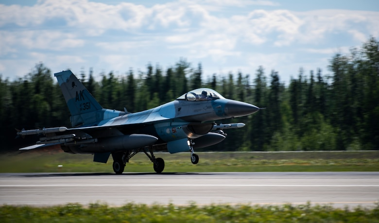 An F-16 Fighting Falcon from the 18th Aggressor Squadron takes off from Eielson Air Force Base, Alaska, June 5, 2019. The 18th AGRS mimics the paint schemes and flying techniques from foreign nations' air forces to create a realistic training opponent for pilots across the Air Force. (U.S. Air Force photo by Senior Airman Stefan Alvarez)