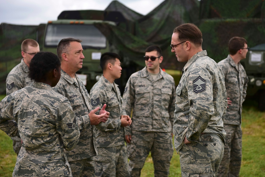 Members of the 123rd Air Control Squadron, an Air National Guard unit from Cincinnati, discuss a shift change at the 606th Air Control Squadron's radar site outside Pula, Croatia, May 28, 2019. The 123rd ACS augmented the 606th ACS during Astral Knight 19, a joint, multinational exercise designed to test Europe and NATO's integrated air and missile defense capabilities. (U.S. Air Force photo by Tech. Sgt. Tory Cusimano)