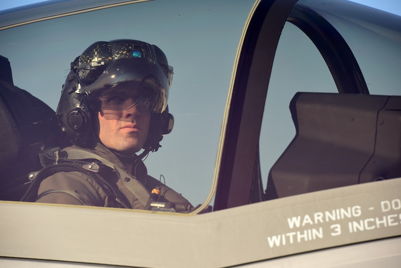 An F-35A Lightning II pilot looks out his canopy during Astral Knight 2019 on June 3, 2019, at Aviano Air Base, Italy. The F-35A is designed to provide the pilot with unsurpassed situational awareness, positive target identification and precision strike in all weather conditions. (U.S. Air Force photo by Tech. Sgt. Jim Araos)