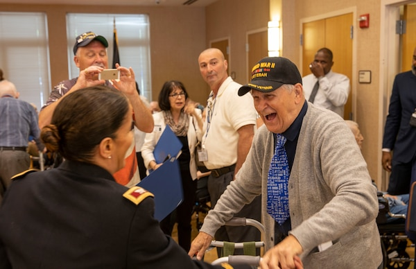 New York Army National Guard Col. Isabel Smith, Chief of Staff of the 53rd Troop Command, greets a World War II veteran at the New York State Veterans Home on Montrose, N.Y. on June 6,  2019 during an event organized by New York Gov. Andrew M. Cuomo to recognize veterans. Smith was one of five National Guard senior leaders who visited the five state veterans home to present New York State Medals to service members who served on D-Day or in the European Campaign.