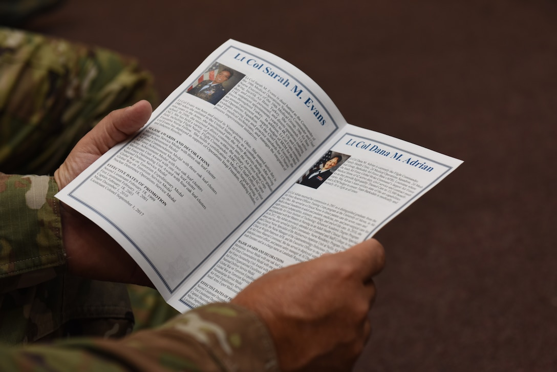 Col. Paul Quigley, 39th Weapons Systems Security Group commander, reads a program during a change of command ceremony June 7, 2019, at Incirlik Air Base, Turkey. The program includes the biographies from both the incoming and outgoing commanders, their duty history, awards and achievements. (U.S. Air Force photo by Staff Sgt. Matthew J. Wisher)