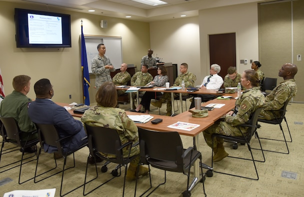 Pharmacy Manager Maj. Karl Bituin with the 72nd Medical Group, informs 72nd Air Base Wing senior leaders of priorities the group has to improve patient experience at their Art of the Possible Walk the Wall event on May 28.