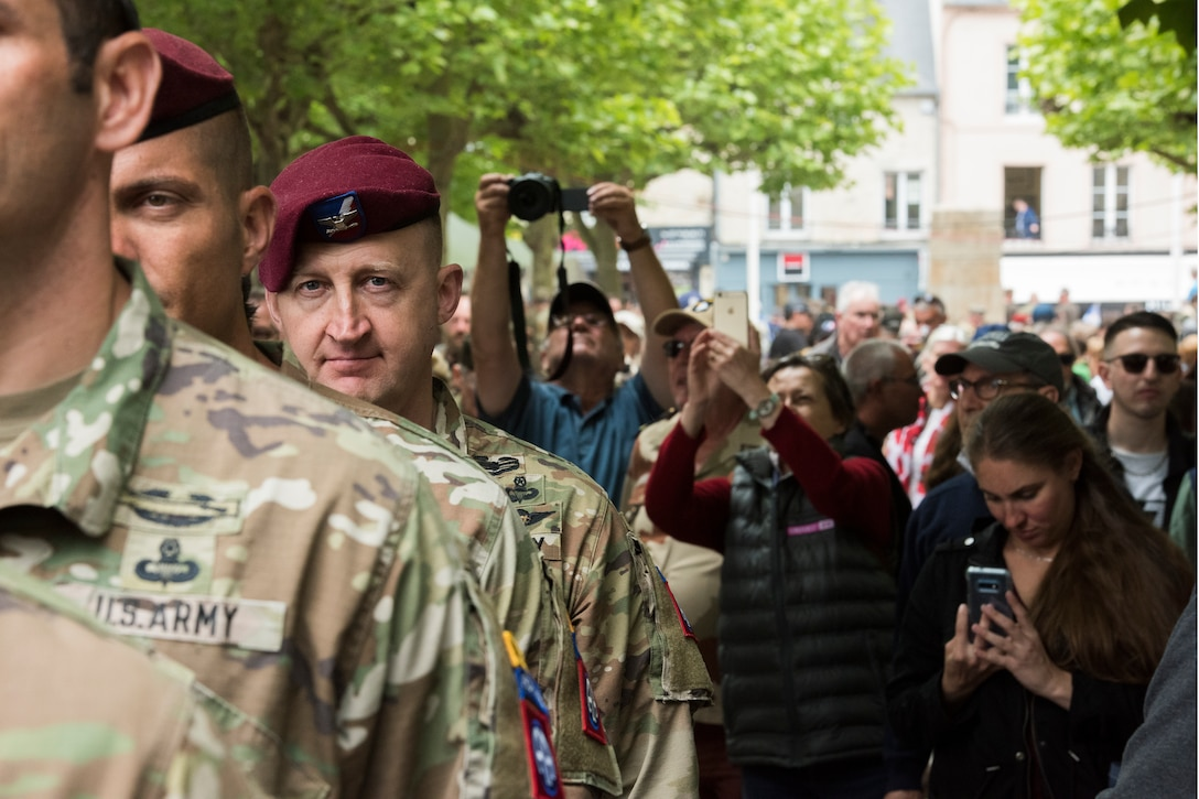 U.S. Army Col. Jon Beale, 82nd Airborne Division Sustainment Brigade commander, stands at attention with fellow airborne infantrymen before filing into the Sainte-Mère-Église Church to honor those that paid the ultimate sacrifice on D-Day, 75 years ago, in Sainte-Mère-Église, France, June 6, 2019. In total, approximately 1,000 U.S. service members participated in the 75th anniversary of D-Day commemorations, which consisted of 55 ceremonies and events across 40 French communities in the region of Normandy, France. (U.S. Air Force photo by Senior Airman Kristof J. Rixmann)