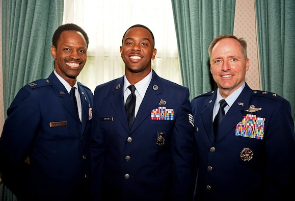 U.S. Air Force Capt. Kenny Neal, 100th Air Refueling Wing chaplain, Staff Sgt. Dajuantaye Brown, 100th Civil Engineer Squadron crew chief, and Maj. Gen. John Wood, Third Air Force commander, pose for a photo during a visit to RAF Mildenhall, England, May 31, 2019. Wood spent time during his visit to discuss leadership and acknowledge the hard work the Airmen of the 100th ARW displays each day. (U.S. Air Force photo by Airman 1st Class Brandon Esau)