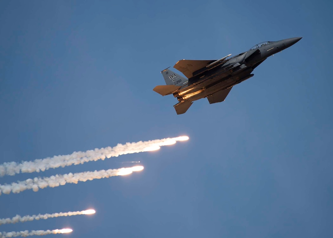 An F-15E Strike Eagle shoots out flares