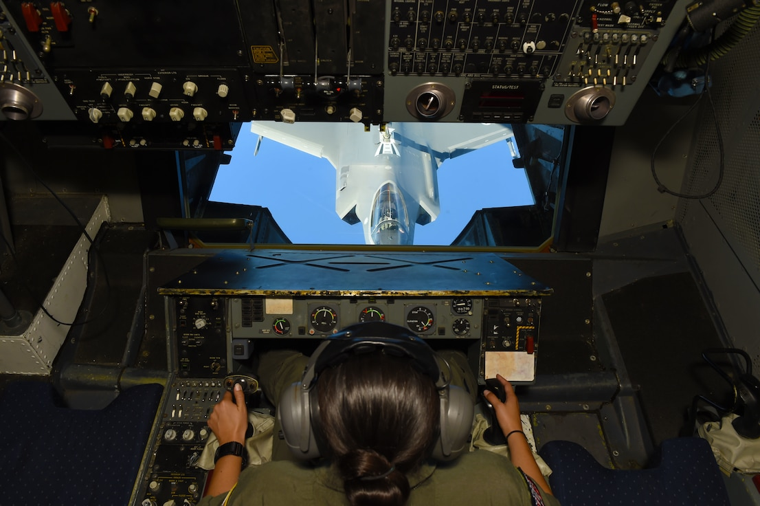 An Airman operates the fuel injection arm of a KC-10 Extender connected to an F-35 Lightning II