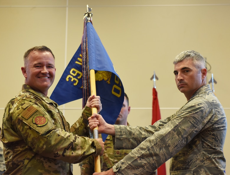 Col. Paul R. Quigley, 39th Weapons System Security Group commander, left, presents the Meritorious Service Medal to Lt. Col. John A. Talafuse, outgoing 39th Operations Support Squadron commander, during a change of command ceremony June 6, 2019, on Incirlik Air Base, Turkey. During his time as commander, Talafuse oversaw 80,000 operations at the U.S. Air Force's busiest air traffic control complex in Europe. (U.S. Air Force photo by Senior Airman Joshua Magbanua)