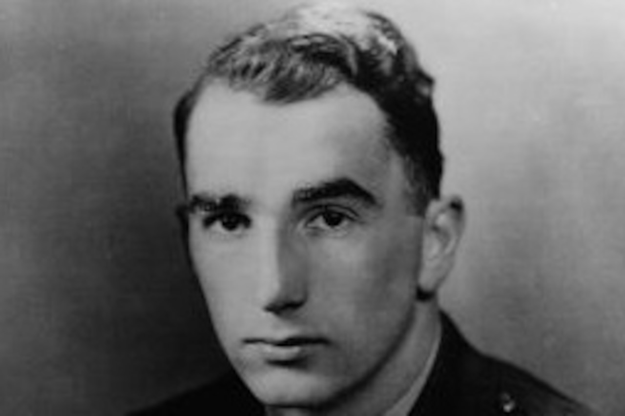 A black and white photograph of a Navy officer.