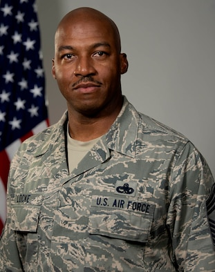 Chief Master Sgt. Dajuan Locke, 749th Aircraft Maintenance Squadron flight superintendent, poses for a photo at Travis Air Force Base, California, June 2, 2019. (U.S. Air Force photo by Tech. Sgt Daniel Phelps)