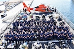 Acting Secretary of Homeland Security Kevin McAleenan, Rear Adm. Peter Brown and The Coast Guard Cutter Hamilton (WMSL-753) crew stand on the flight deck amongst 26,000 pounds of interdicted cocaine and 1,500 pounds of interdicted marijuana at Port Everglades, Florida, June 6, 2019. The drugs were interdicted in international waters of the Eastern Pacific Ocean off the coasts of Mexico, Central and South America and include contraband seized and recovered in over a dozen interdictions of suspected drug smuggling vessels by U.S. Coast Guard and Royal Canadian Navy ships. Coast Guard Photo by Petty Officer 3rd Class Brandon Murray.