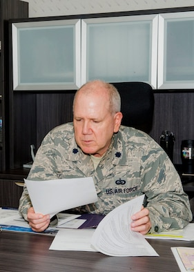 Lt. Col. Eric Kase reviews paperwork in his new office at Grissom Air Reserve Base, Ind., June 5, 2019. Kase recently became the operations officer for the 434th Force Support Squadron