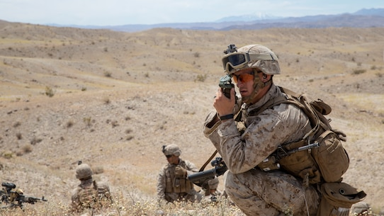 U.S. Marine Corps Lance Cpl. Samuel M. Metz, a machine gunner with 5th Battalion, 1st Marine Regiment, 1st Marine Division, plots his minimal safety line during an integrated training exercise at Marine Corps Air Ground Combat Center, Twentynine Palms, California, April 28, 2019.