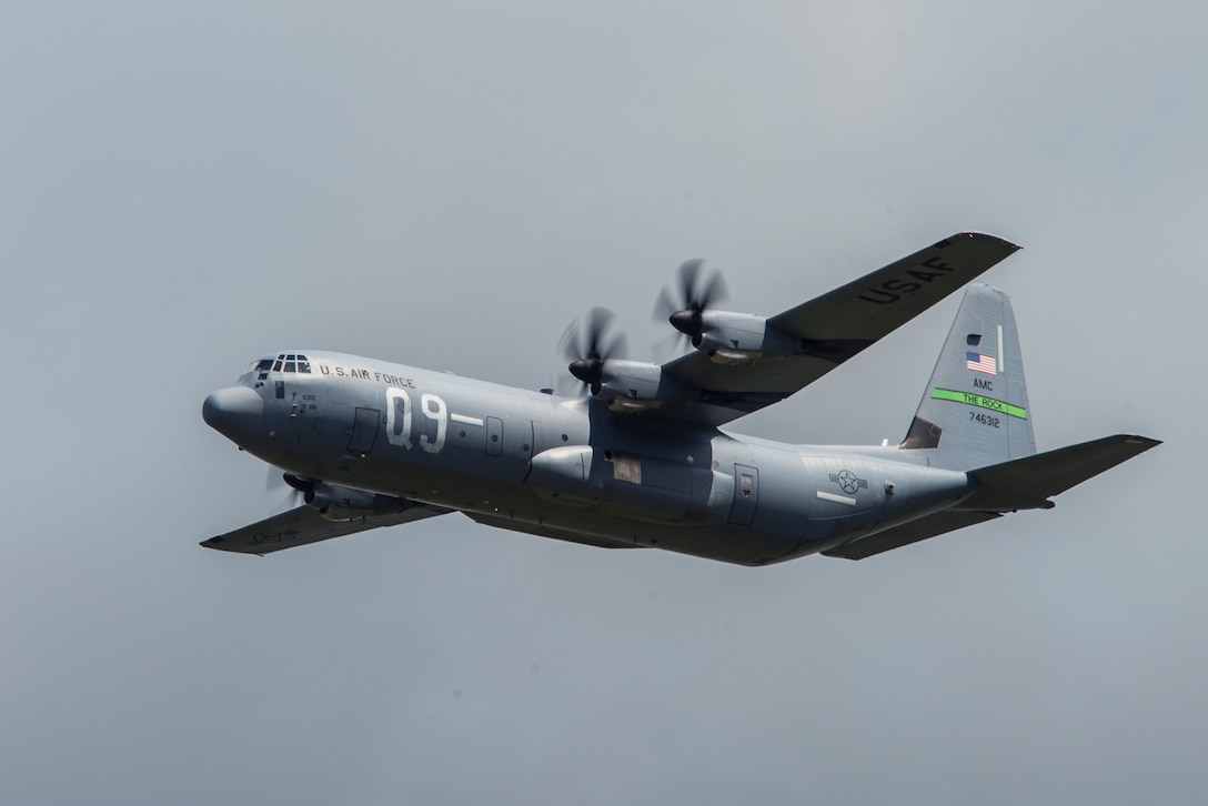 """A U.S. Air Force C-130J Super Hercules, assigned to the 61st Airlift Squadron, Little Rock Air Force Base, Ark., flies over Cherbourg-Maupertus Airport, France, June 6, 2019. The 61st AS' lineage stems from the 61st Troop Carrier Squadron, who wore the """"Q9"""" identifier during the airdrops conducted over Normandy during Operation Neptune June 6, 1944. (U.S. Air Force photo by Senior Airman Devin M. Rumbaugh)"""