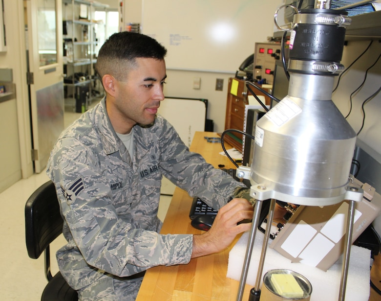Staff Sgt. Kyle Hipol, 711th Human Performance Wing Defense Occupational and Environmental Health Readiness System support office consultant, calibrates a piece of radiac equipment used by the Air Force radiation assessment team. Hipol applied the Comprehensive Fitness training he received and incorporated physical fitness as an outlet to overcome adversity. Hipol took up running and is now registered to run the Air Force Marathon on Sept 21.  (U.S. Air Force photo/Stacey Geiger)