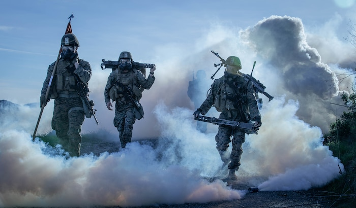 U.S. Marines from 1st Battalion, 1st Marine Regiment, 1st Marine Division hike through a simulated chemical attack at Marine Corps Base, Camp Pendleton, California, Jan. 12, 2019.
