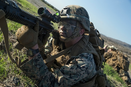 U.S. Marine Corps Lance Cpl. Angel Martinez, a rifleman with 2nd Battalion, 1st Marine Regiment, 1st Marine Division, posts security during an Air Raid Course at Marine Corps Base Camp Pendleton, California, Dec. 11, 2018.