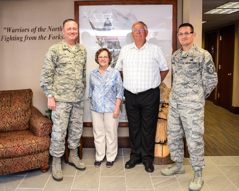 Col. Benjamin Spencer, 319th Air Base Wing commander, and CMSgt Ryan Thuyns, 319 ABW command chief, recognize Patricia Wacek, Gold Star Family Member, and Kevin Wacek, her spouse, June 7, 2019 during a tour at Grand Forks Air Force Base, North Dakota. Gold Star Family Members are immediate family members of service members who were killed in combat, through an act of terrorism, declared missing in action or a prisoner war. (U.S. Air Force photo by Senior Airman Elijaih Tiggs)