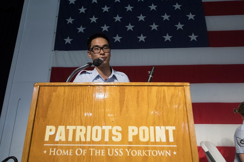 Airman 1st Class Louis Kim, a clarinet player with the U.S. Air Force Heritage Winds, introduces himself to the crowd during a performance June 6th, 2019, in Mount Pleasant, S.C.