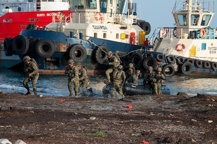 Mexican Navy personnel arrive by boat during the final exercise scenario for the first phase of Exercise Tradewinds 19.