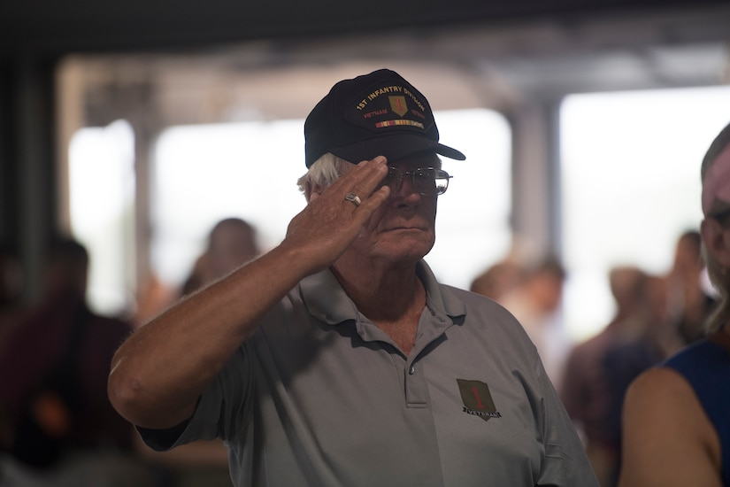 A Vietnam veteran salutes the flag during the National Anthem before a U.S. Air Force Heritage Winds concert June 6th, 2019, in Mount Pleasant S.C.