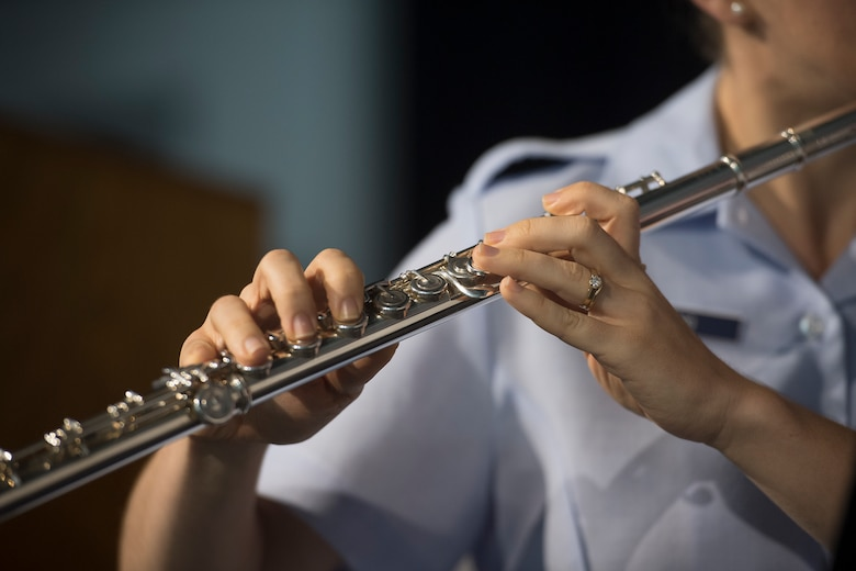 Airman 1st Class Andrea Murano, a flute player with the U.S. Air Force Heritage Winds, performs for veterans and community members June 6, 2019, in Mount Pleasant, S.C.