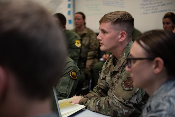 A Squadron Officer School students listen as they recieve initial feedback on their Think Tank elective presentation, May 31, 2019, Maxwell Air Force Base, Alabama. The students were given the challenge to figure out how Artificial Intelligence could be used to solve Air Force issues and better processes.