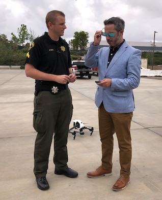 San Diego Sheriff Department Deputy Alex Roti and Comisario Gerardo Andres Valenzuela, Policia de Investigaciones (PDI) Santiago, Chile, flank a drone during the first Unmanned Aerial Systems Seminar in California hosted by AFOSI FPD, Chile, May 20-24, 2019. (Photo submitted by SA Carlos Vargas, FPD, Chile)