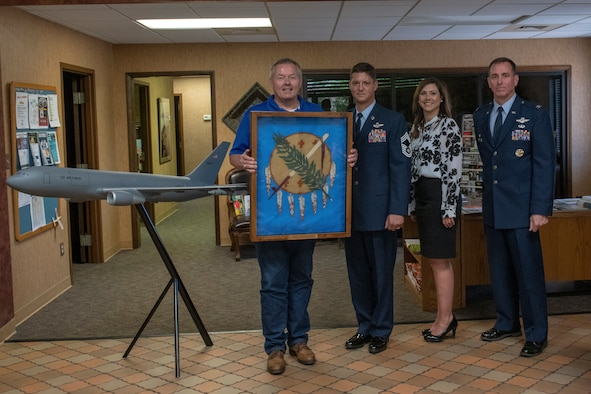 Col. William Mickley, 97th Operations Group commander, and Chief Master Sgt. Jason Hall, 97th Operations Group command chief, present the first Oklahoma Flag flown on the KC-46A Pegasus to the 97th Air Mobility Wing to the president of the Chamber of Commerce, June 7, 2019, at Altus, Okla. The flag was a gift to the Chamber for their support of the 97th Air Mobility Wing.