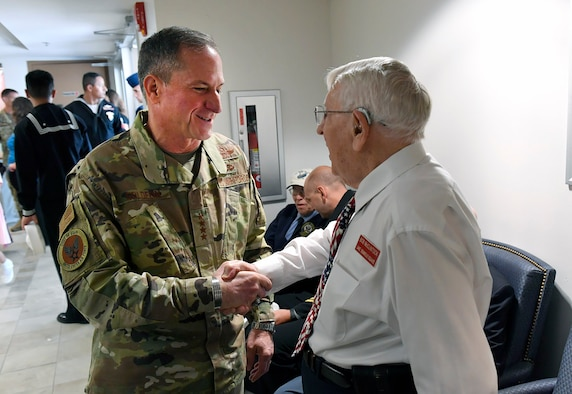 U.S. Air Force Gen. David Goldfein, Chief of Staff of the Air Force, greets 1st Lt. Bob McClintock, a World War II veteran, at a commemoration of the 75th anniversary of the D-Day invasion at MacDill Air Force Base, Fla., June 6, 2019.